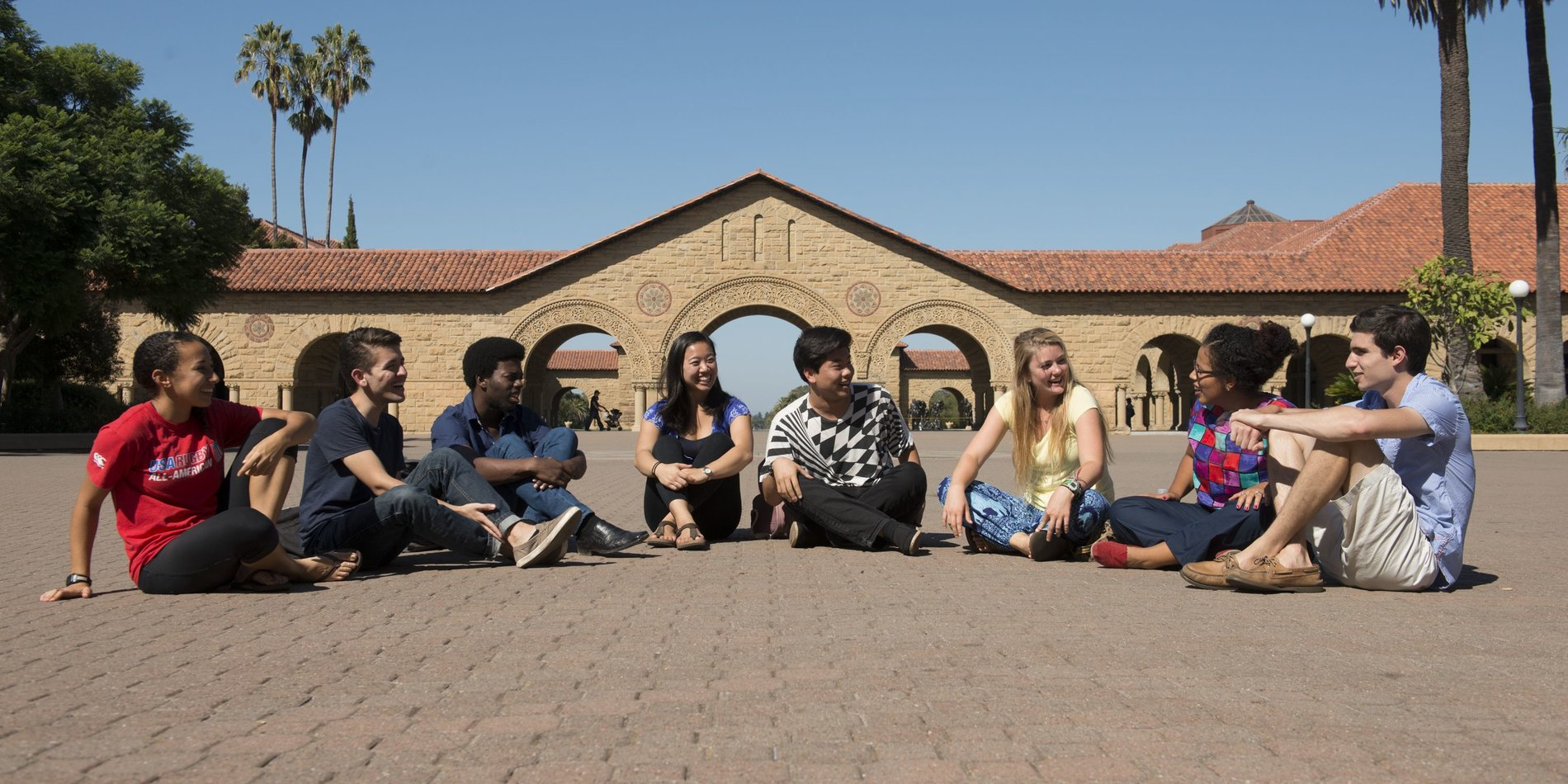 Image of a group of students sitting in the Main Quad